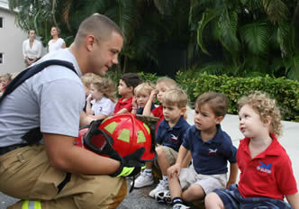 Fire Fighter teaches kids about fire safety