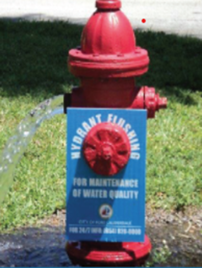 image of fire hydrant being flushed for free chlorination