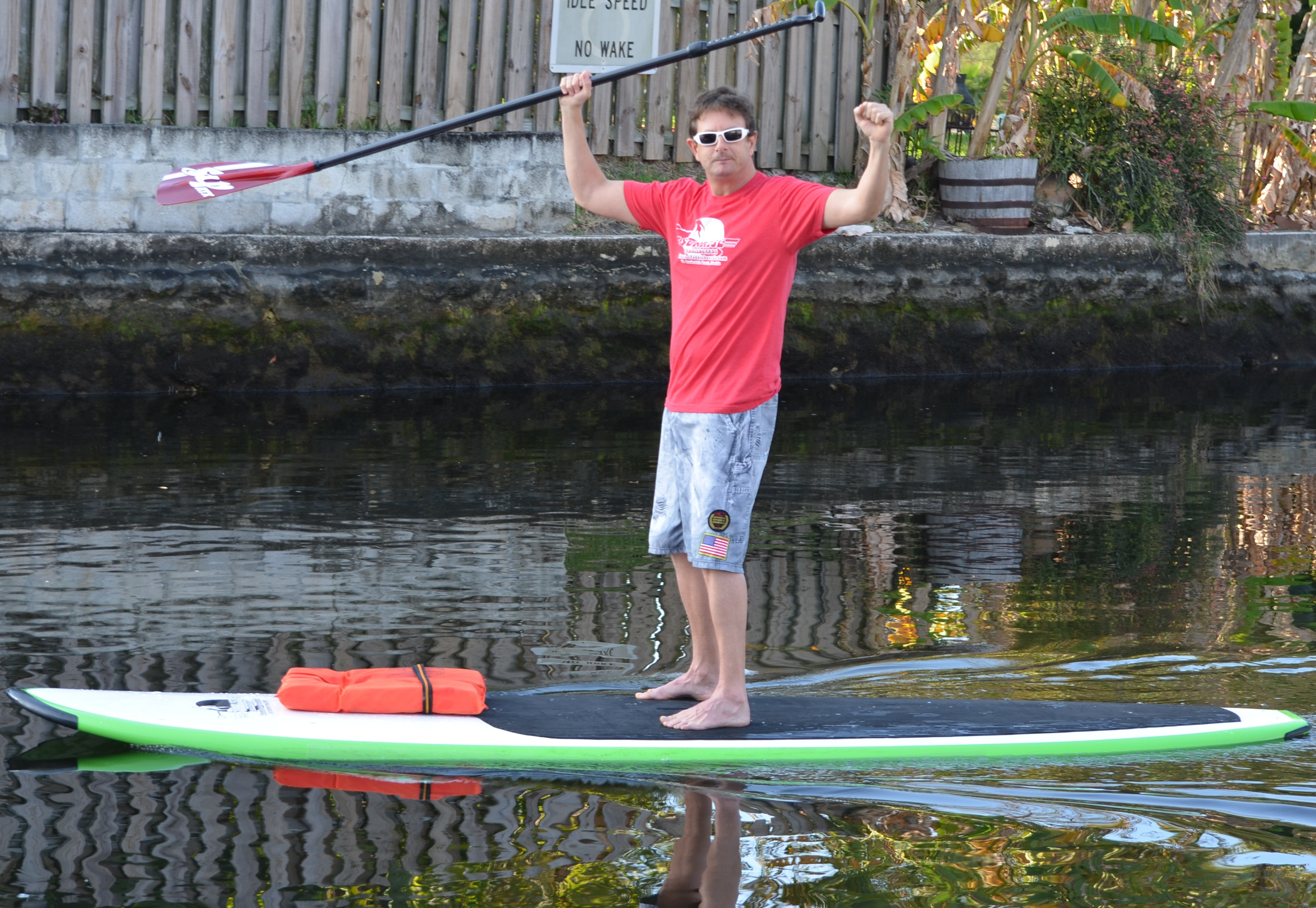 Brian on paddleboard cheers 2 2013